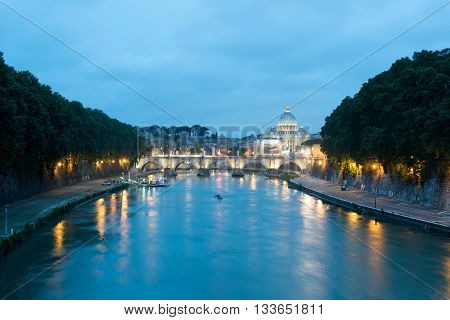 View on St. Peter´s Basilica by night across the Tiber River, Rome, Italy