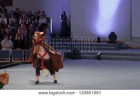 BRNO CZECH REPUBLIC - APRIL 30 2016: Cosplayer dressed as character Holo from Anime Spice and Wolf during cosplay contest at Animefest anime convention on April 30 2016 Brno Czech Republic