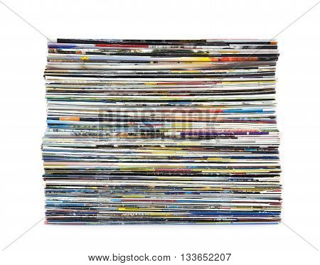 Stack of colorful magazines on white background