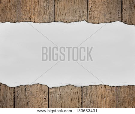 Wooden background with empty text space made of torn paper