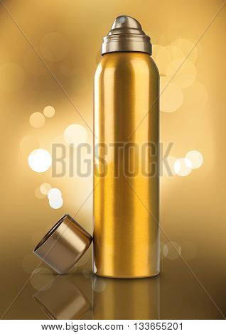 Gold Deodorant Perfume Can or Bottle Bokeh Background
