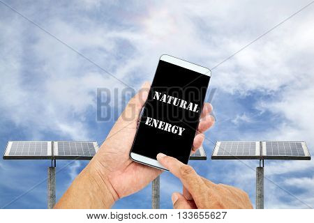 man using mobile smart phone control with Outdoor small solar panel isolated on sky background natural energy concept