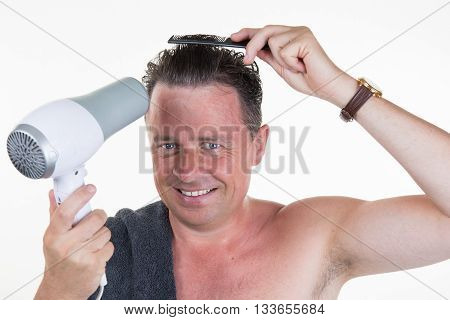 Happy And Cheerful Man In His Bathroom With Hair Dryer
