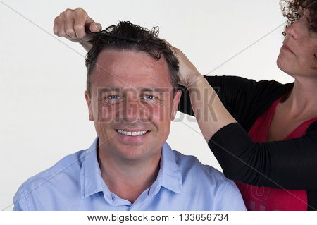 Cheerful Guy Cuts Hair At The Hair Salon By Woman