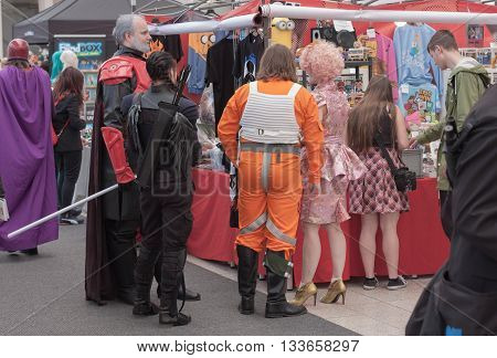Group Of Cosplayers Showing  Products At Market