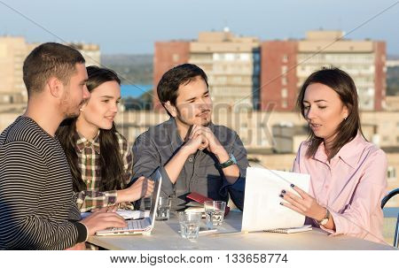Young Smart Casual Clothing People Business Meeting with Urban Landscape Background