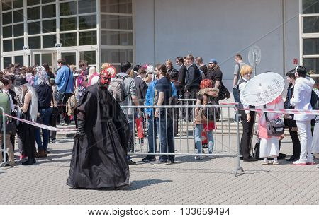 BRNO CZECH REPUBLIC - APRIL 30 2016: Cosplayer dressed as character Darth Maul from Star Wars walks around visitors queue at Animefest anime convention on April 30 2016 Brno Czech Republic
