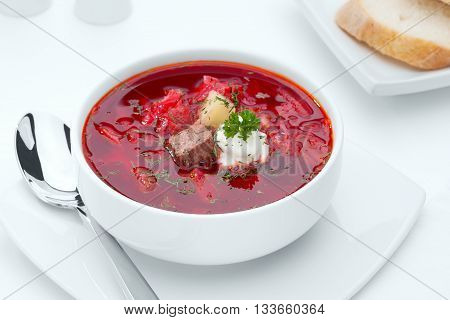 close up view of nice yummy red russian soup on white back
