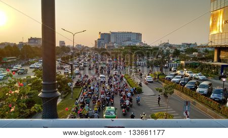 Ho-Chi-Minh-City (Saigon), Vietnam, 21st March 2016. Traffic jam at one of the main intersections. Every day the streets are filled with uncountable motorbikes, cars, bus and trucks.