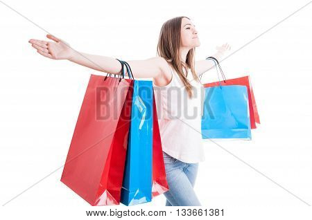 Freedom Concept With Beautiful Shopaholic Standing With Arms Wide Open