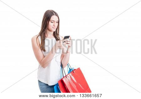 Shopping Woman Texting On Her Mobile Phone And Holding Bags