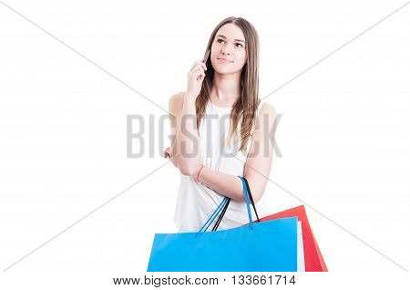 Young Woman Shopper Talking On The Phone And Looking Away