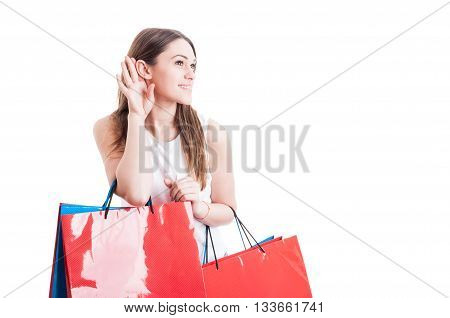 Beautiful Young Shopper With Paper Bags Listening Gossip