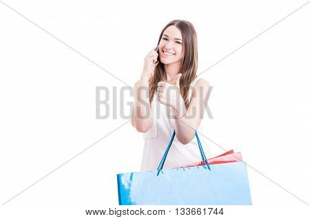 Cheerful Shopaholic Talking On Cellphone And Showing Like Sign