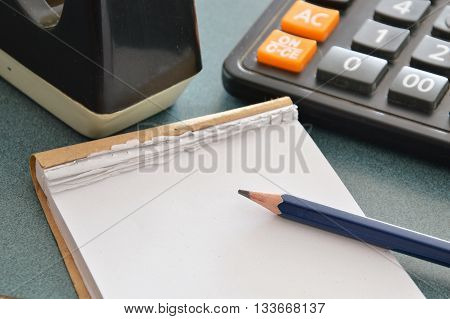 paper notebook and pencil on counter cashier in shop
