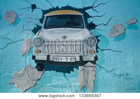 BERLIN, GERMANY - MAY 10, 2016: restored mural by the female artist Birgit Kinder at the East Side Gallery in Berlin. Many tourists have left in artworks smearings. These were removed by the restoration. The East Side Gallery is provided to protect agains