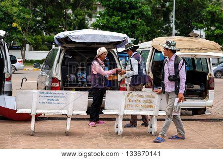 Photographer man in a park. VIENTIANE, LAO
