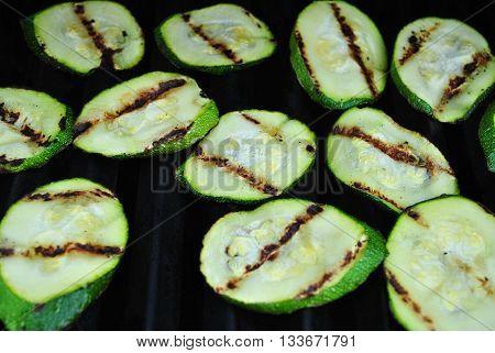 Grilling Fresh Green Zucchini Squash on a Hot Summer Day