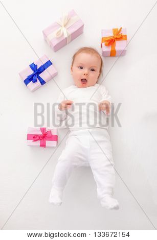 funny cute little newborn with presents