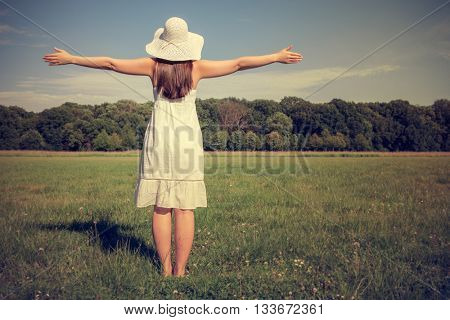 girl with hat enjoying freetime