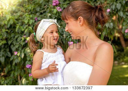 green garden with her little daughter