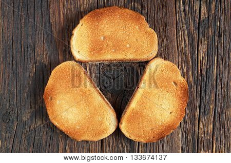 Background with roasted bread on dark wooden table top view