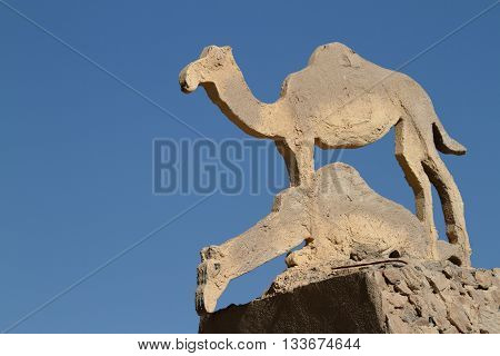 A Camels and dromedaries sculpture in the sahara