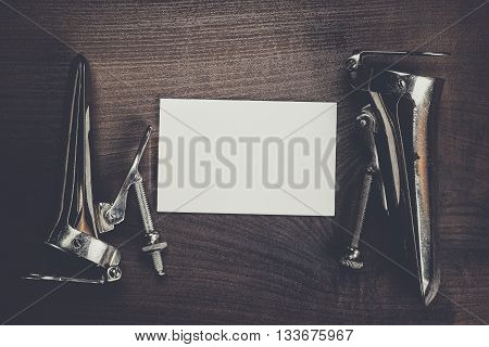 metal vaginal speculums and blank notebook on the table