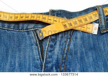 measuring tape on the jeans on white background