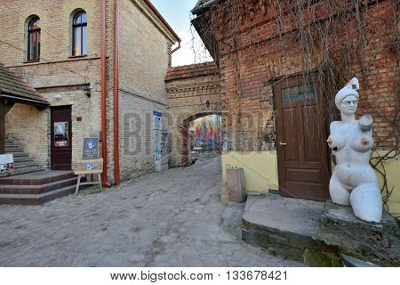 VILNIUS LITHUANIA - MARCH 18: Uzupis district on March 18 2015 in Vilnius Lithuania. The district has been popular with artists for some time due to its bohemic and laissez-faire atmosphere
