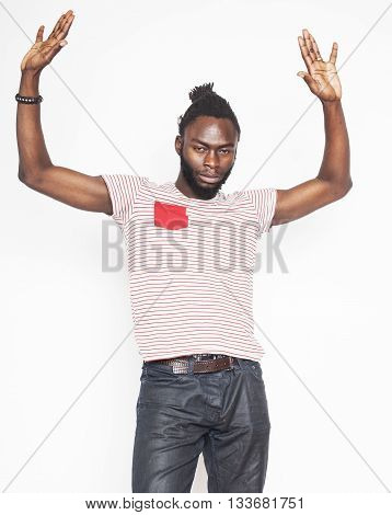 young handsome afro american boy in stylish hipster hat gesturing emotional isolated on white background smiling close up