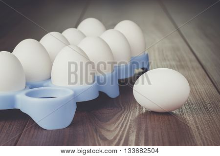 some eggs on the brown wooden table
