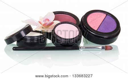 Cosmetic brush for makeup, eye shadow, blush and orchid flower isolated on white background.