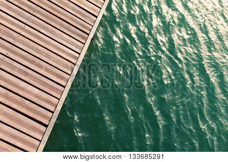 view from above of wooden pier. summer holiday