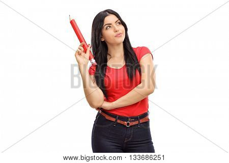 Vertical shot of a pensive young woman holding a huge pencil isolated on white background