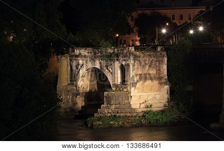 Ponte rotto Roman bridge at night in Rome Italy