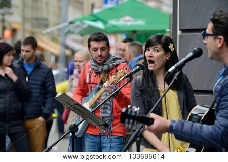 VILNIUS LITHUANIA - MAY 16: Unidentified musician sings in Street Music Day on May 16 2015 in Vilnius. Its a most popular event on May in Vilnius Lithuania