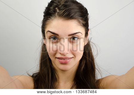 Happy Cute Woman Making Selfie Over Gray Background