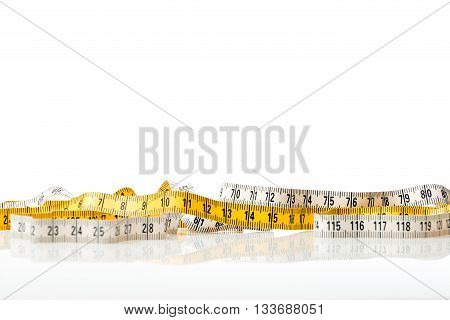 Yellow And White Measure Tape
