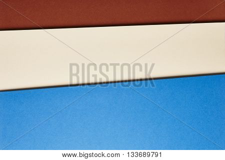 Colored cardboards background in brown beige blue tone. Copy space. Horizontal