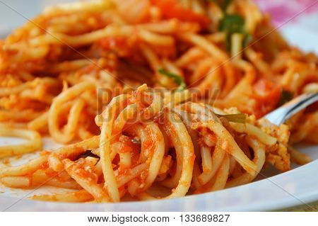 stir-fried spaghetti with egg and tomato roll over fork fork