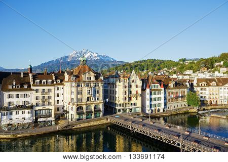 LUCERNE SWITZERLAND - MAY 05 2016: Old colorful buildings along the river shows unique character of Old Town and it looks to be tuned with modern times and offers variety of sightseeing attractions