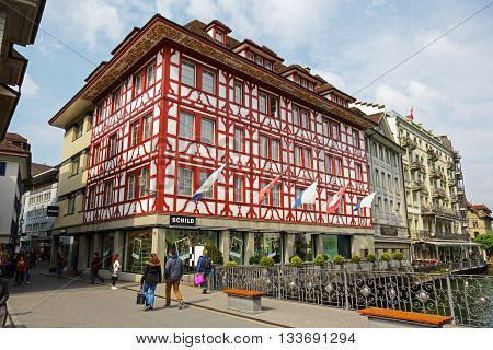 LUCERNE SWITZERLAND - MAY 02 2016: Half-timbered building along the river Reuss shows unique character of the city that offers variety of tourist attractions both from history and from modern times