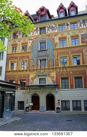 LUCERNE SWITZERLAND - MAY 02 2016: A fascinating work painted in 1893 by Seraphin Weingartner on the facade of The Hotel des Balances that is located in heart of the old city