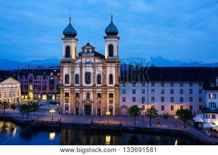 LUCERNE SWITZERLAND - MAY 02 2016: Night view towards the Jesuit Church located by the Reuss river in old town. It is widely believed to be the most beautiful Baroque church in Switzerland