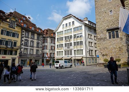 LUCERNE SWITZERLAND - MAY 02 2016: Buildings at the nice square in the old town called Kornmarkt looks to be tuned with modern times and offers variety of sightseeing attractions