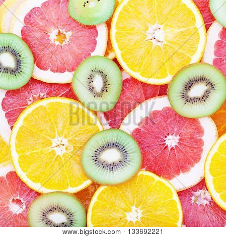 Fruits background macro. Citrus fruits top view macro selective focus. Fruit Mix like bright background