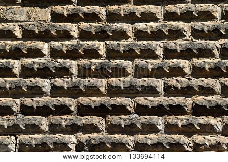 Old stone brick wall exterior background at historic Cotton Gin.