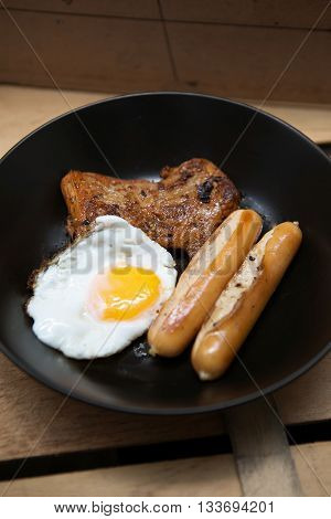 Homemade foods - Chicken fillet grilled steak and egg fried on wooden background