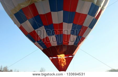 the gas burner flame under the air balloon before the start